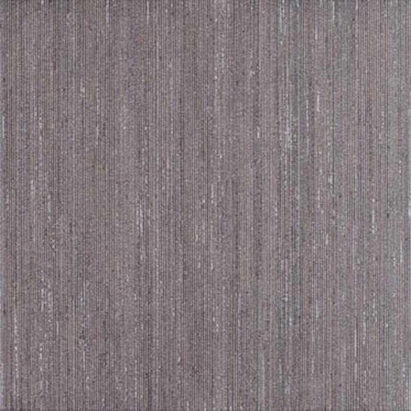 Sierlijke vloertegel in de kleur bruin van Gijsberts tegels, sanitair, badkamers en keukens